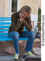 Sad lonley mature woman - Woman sitting on bench depressed...