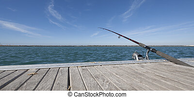 fishing rod in dock - launched a fishing rod waiting