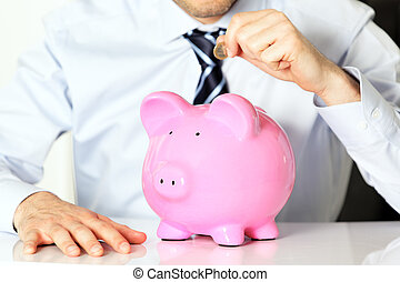 investor - businessman with coin and pink piggy bank