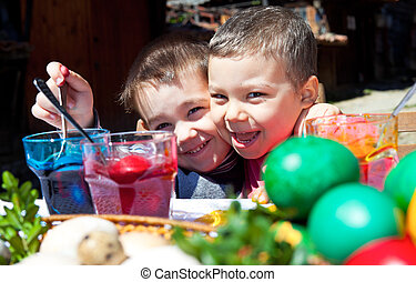 excited kids colouring easter eggs - Two smiling little boys...