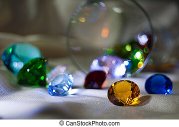 Defocused overturned glass with gems - Defocused overturned...