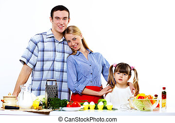 family with a daughter cooking together at home - Happy...