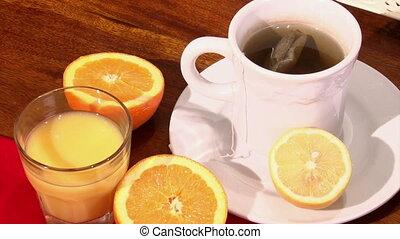 Orange juice, tea. Healthy eating.