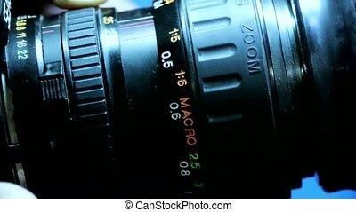 Manually adjust camera lens.