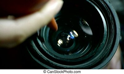 Manually clean camera lens.