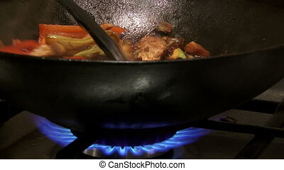 Chinese food in wok, 2 clips - Chinese food in wok, flame,...