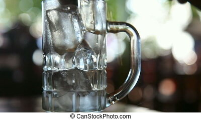 Cola and ice - Cola and ice in a glass mug