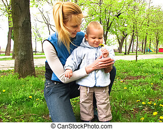 Mother and son on a walk in the Spring Park