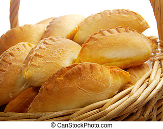 Basket full of pasties isolated  on white
