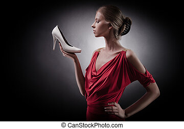 Beautiful woman in red dress. Girl and shoe