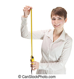 woman wearing a white shirt holding a tape measure shot in...