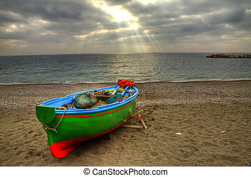 Fishing boat on the beach of Atrani (SA) during a storm