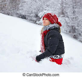 Young woman having fun in the snow