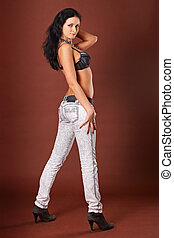 Young beautiful girl in jeans