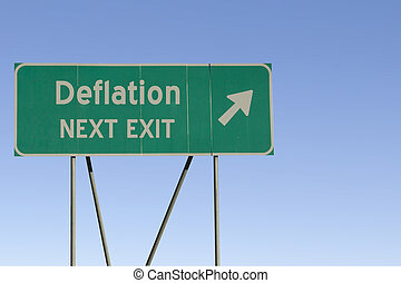 Deflation - Next Exit Road - Green road sign with a blue sky...