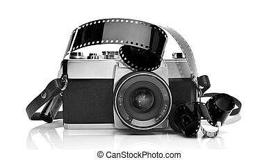 Old 35mm film photo camera on white background with 35mm...