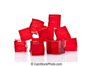 Cubes of red jelly on a white background