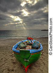Fishing boat on the beach of Atrani (SA) during a rainstorm