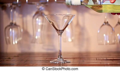 Martini pouring into a glass