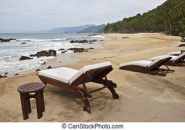 Lounge chairs on a beach - Lounge chairs on a remote Pacific...