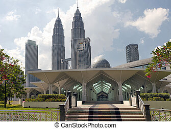 Masjid Asy-Syakirin Muslim Mosque in Kuala Lumpur City Center Park  with Downtown Skyline Malaysia