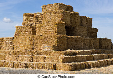 Large stack of square hay bales - A large stack of square...