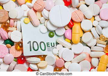 Lot of pills and one hundred euro banknote under them