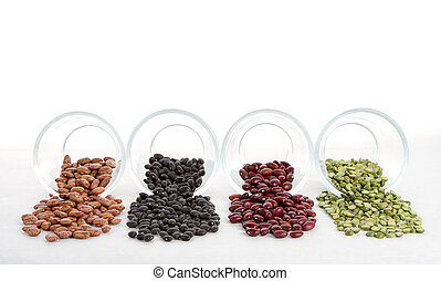 Beans and split peas spilling out of glass jars