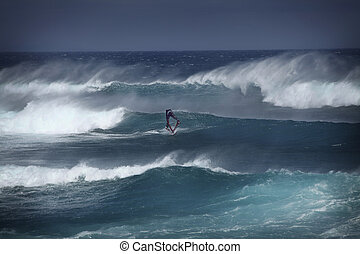 Windsurfer in big waves on Maui