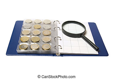 Album for coins and magnifying glass isolated on white