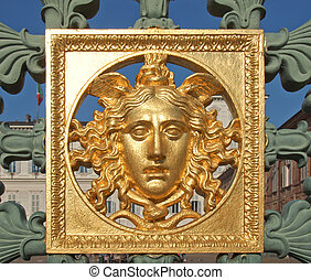 Palazzo Reale, Turin - Ancient baroque golden mask on...