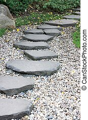 Paved garden path in autumn - Garden path paved with a...