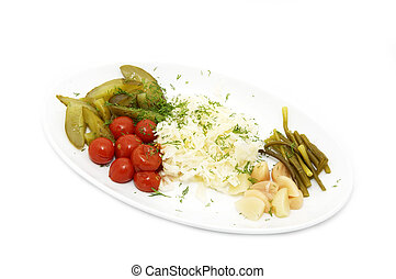 vegetables on a plate on a white background