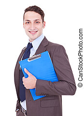 Businessman smiles with clipboard in his hand