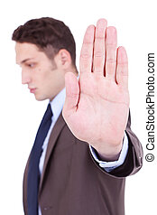 Business man showing stop gesture young businessman saying...