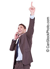 happy business man with cellular phone winning over white...