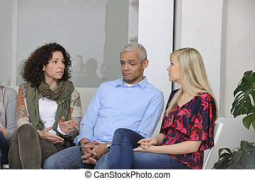 group therapy: diverse people giving support - group...