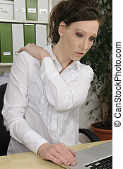 Business woman suffering from severe neck pain - Portrait of...