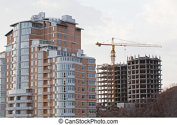 building elevating crane on a background of a under...