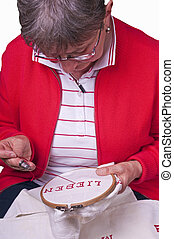 pensioner does embroidery