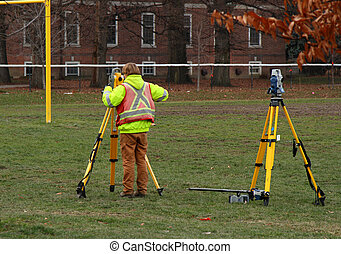 cartographer doing land survey for construction