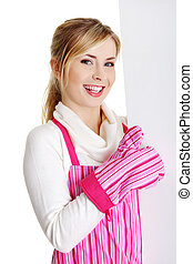 Happy woman in pink appron holding sign billboard.