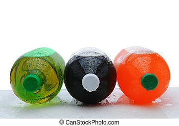 Three large soda bottles on their sides