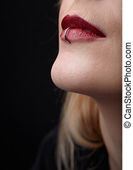 Pierced Red Lips - Pierced red lips of young adult caucasian...