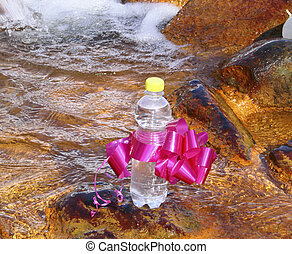 A bottle mineral waters on stones in water