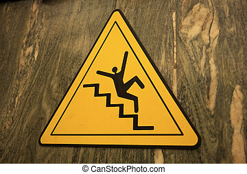 Careful on the stairs - sign in the building. Seen in Rome.