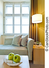 Window illuminates a seating area with fruit in the...