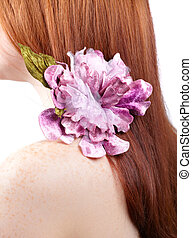 Redhead with flower - Detail on the hair of a red head woman...
