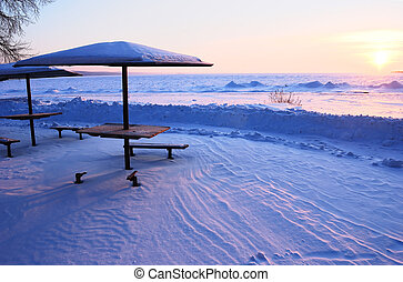 beautiful beach in the winter snow and umbrella