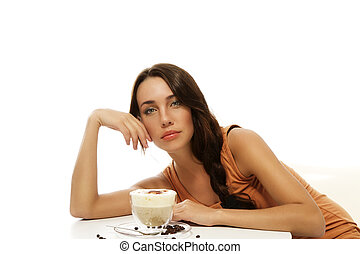beautiful woman bending over cappuccino on a table on white...